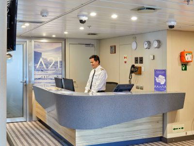 Reception desk on board Magellan Explorer. Photography by Tom Arban.